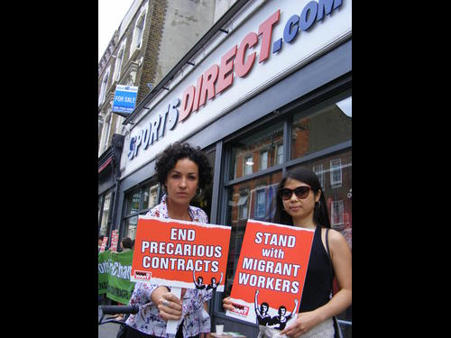 War on Want supporters protest outside a SportsDirect Shop, Hackney. Credit: War on Want