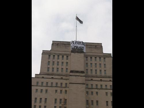 """We Exploit Workers"" Protesters dropped a banner on top of the University in solidarity with workers on strike."