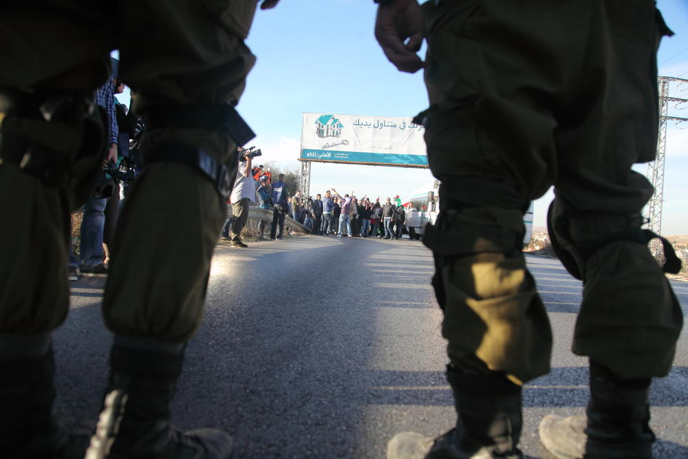 Israeli soldiers and a Palestinian demonstration