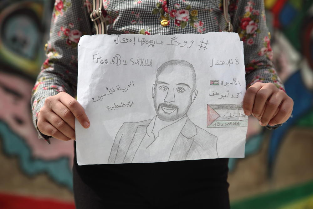 Abu Sakha's student holds a sign